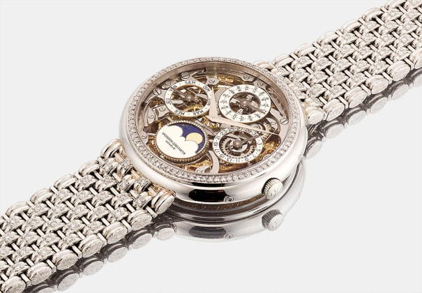 A heavy and impressive platinum and diamond-set skeletonized perpetual calendar wristwatch with moon phases and bracelet