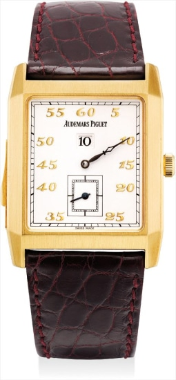 A fine yellow gold minute repeating jump hour wristwatch with certificate and fitted presentation box