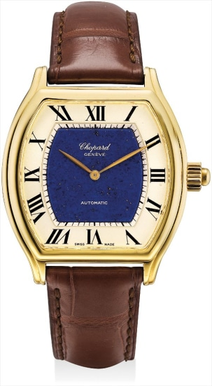 A fine and unique yellow gold tonneau-shaped wristwatch with concealed automata of a man playing polo and lapis lazuli dial