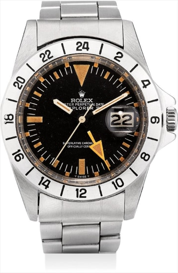 A fine and rare stainless steel dual time wristwatch with sweep centre seconds, date and bracelet