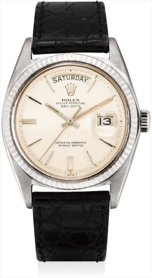 A fine white gold calendar wristwatch with sweep centre seconds