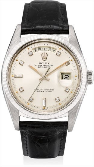 A fine and rare white gold and diamond-set calendar wristwatch with sweep centre seconds