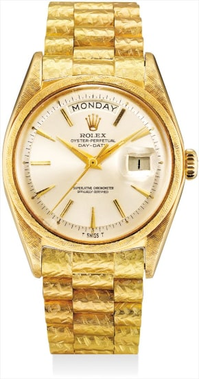 A fine and very rare yellow gold calendar wristwatch with sweep centre seconds, date and unusual bracelet