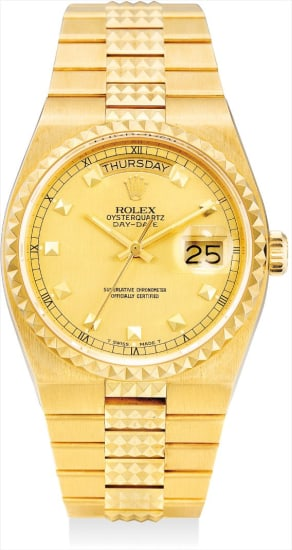 A fine and very rare yellow gold calendar wristwatch with sweep centre seconds, original bracelet and guarantee