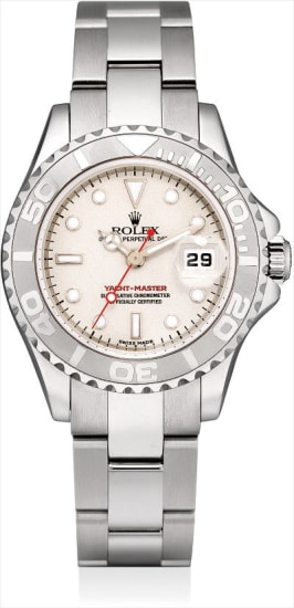 A lady's stainless steel wristwatch with sweep centre seconds, date, platinum bezel and bracelet