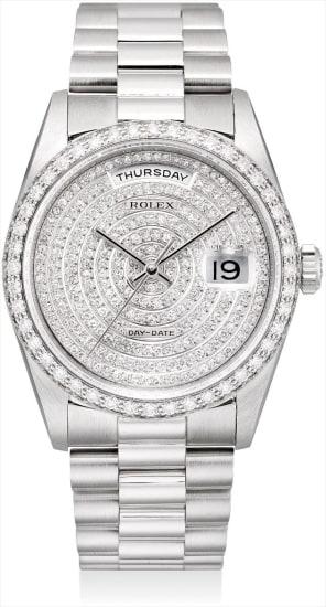 A very fine and rare platinum and diamond-set calendar wristwatch with sweep centre seconds and bracelet