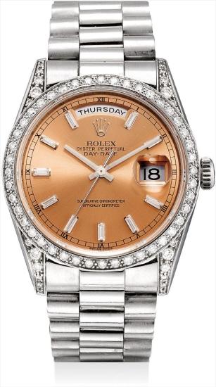 A fine and very rare platinum and diamond-set calendar wristwatch with bracelet and guarantee