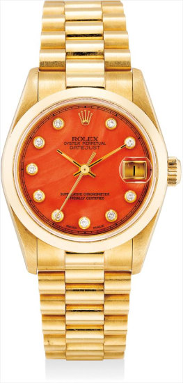 A fine and rare mid-size yellow gold and diamond-set wristwatch with sweep centre seconds, date, coral dial, bracelet and guarantee