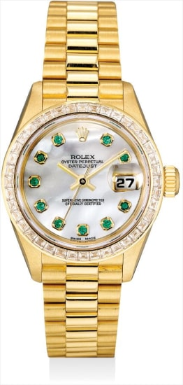 A fine and rare yellow gold, diamond and emerald-set wristwatch with sweep centre seconds, date, mother-of-pearl dial and bracelet