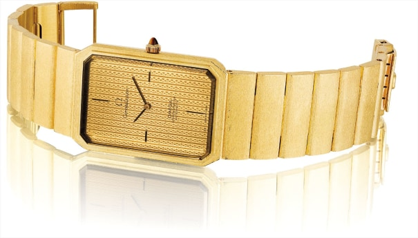 A fine and heavy rectangular yellow gold bracelet watch with tiger's eye crown