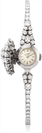 A lady's fine and possibly unique platinum and diamond-set bracelet watch with concealed dial