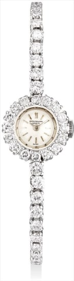 A lady's fine and rare platinum and diamond-set bracelet watch with original certificate and fitted presentation box