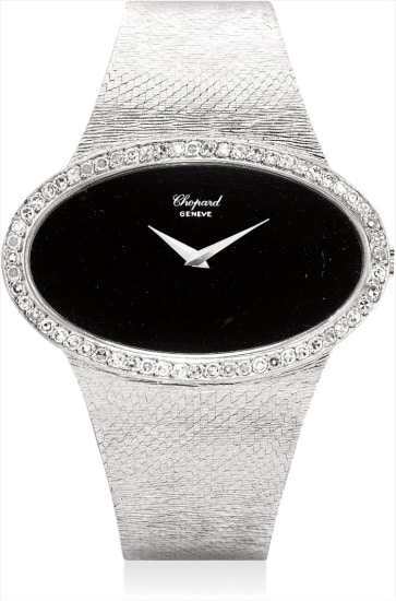A fine and rare white gold and diamond-set oval bracelet watch with onyx dial