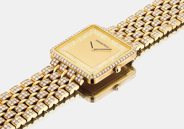 A rare and heavy yellow gold and diamond-set square bracelet watch