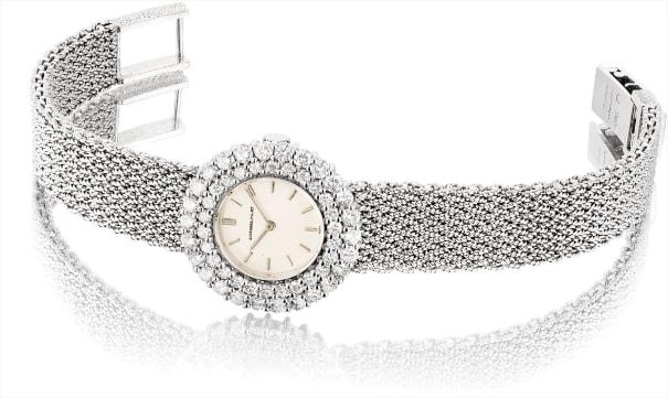 A lady's fine white gold and diamond-set bracelet watch