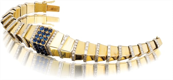 A lady's very fine, rare and oversized yellow gold, cabochon sapphire and diamond-set bracelet watch with concealed dial