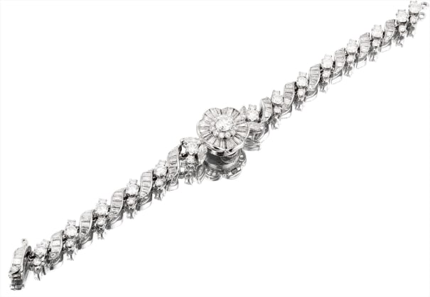 A fine and rare platinum and diamond-set flower-form bracelet watch with concealed dial, movement by LeCoultre