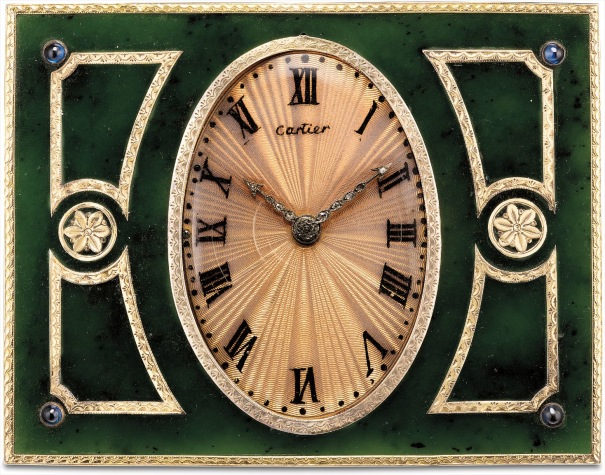 A very fine and rare yellow gold, nephrite, sapphire and diamond-set desk clock with opalescent fluorescent enamel dial and original fitted presentation box