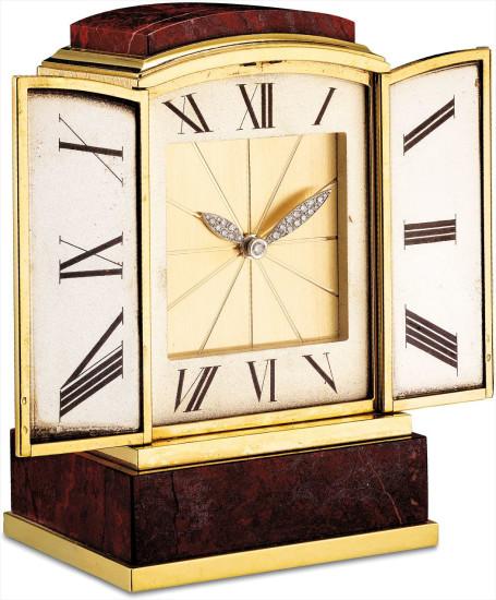 A very fine and extremely rare yellow gold, platinum and diamond-set miniature shutter clock with hardstone mount and original fitted presentation box