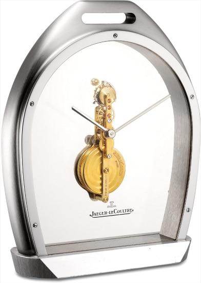 A fine and rare stainless steel tourbillon skeletonised desk clock