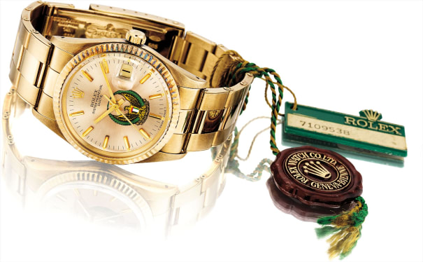 A fine and rare 14k yellow gold wristwatch with sweep center seconds, date and bracelet, made for the United Arab Emirates