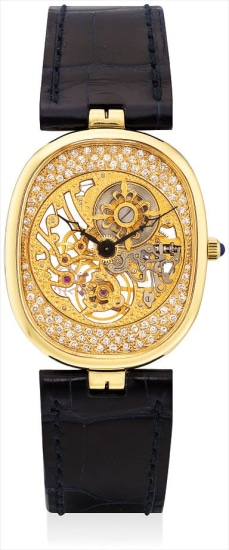 A fine and rare yellow gold and diamond-set cushion-shaped skeletonised wristwatch