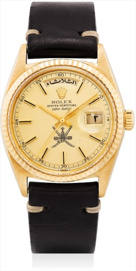 A fine and very rare yellow gold Arabic calendar wristwatch with sweep centre seconds and champagne dial, made for the Sultanate of Oman