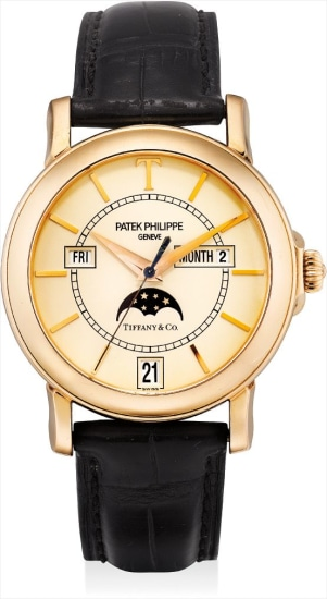 A very fine and rare pink gold limited edition annual calendar wristwatch with sweep centre seconds and moon phases, made to commemorate the 150th anniversary of the relationship between Patek Philippe and Tiffany & Co., retailed by Tiffany & Co.