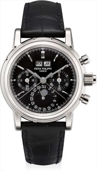 A fine and rare white gold perpetual calendar split seconds chronograph wristwatch with moon phases, 24 hours, leap year indicator, rare glossy black dial, original certificate, additional case back and fitted presentation box