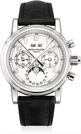 A fine and rare platinum perpetual calendar split-seconds chronograph wristwatch with moon phases, leap year indicator, additional case back and folding deployant clasp, original certificate and fitted presentation box