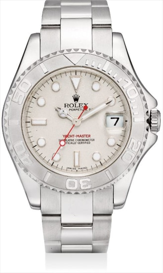 A stainless steel wristwatch with sweep centre seconds, date, platinum bezel and bracelet