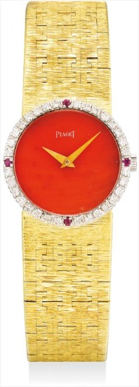 A lady's fine and rare yellow gold, diamond and ruby-set bracelet watch with coral dial