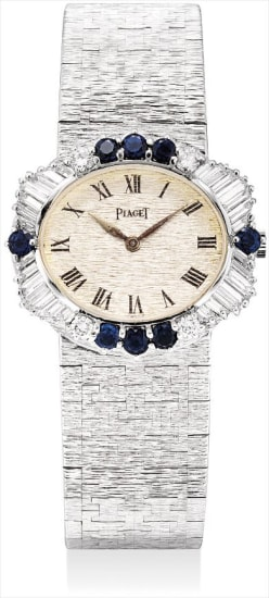 A lady's fine and rare white gold, diamond and sapphire-set oval bracelet watch