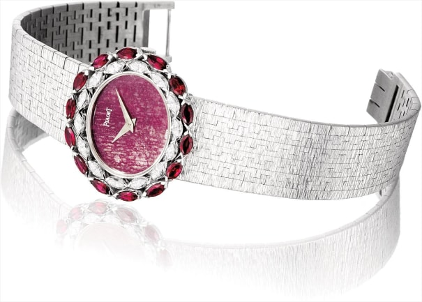 A lady's fine and rare white gold, diamond and ruby-set oval bracelet watch with root ruby dial