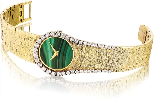 A lady's rare yellow gold and diamond-set bracelet watch with malachite dial