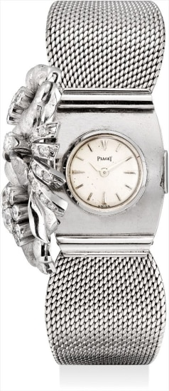 A lady's fine and very rare white gold and diamond-set bracelet watch with concealed dial