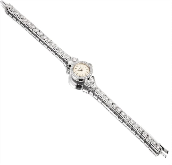 A lady's fine and rare white gold and diamond-set bracelet watch