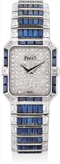 A lady's fine and rare white gold, diamond and sapphire-set rectangular bracelet watch