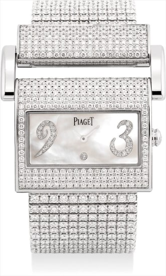 A lady's fine and rare white gold and diamond-set rectangular bracelet watch with mother-of-pearl dial