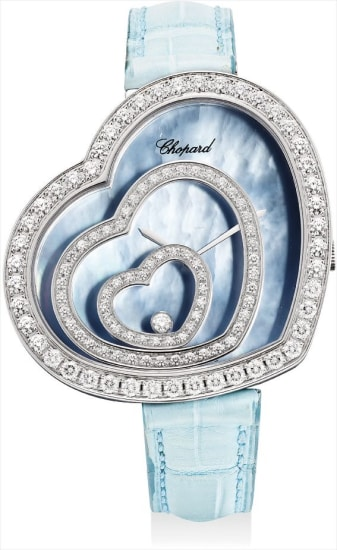 A lady's fine white gold and diamond-set heart-shaped wristwatch with blue mother-of-pearl dial