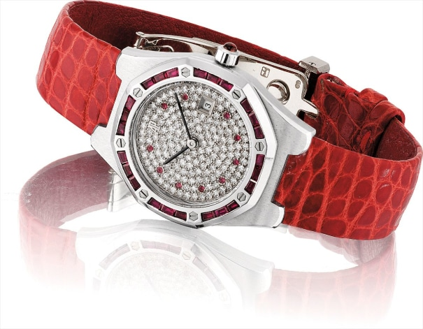 A lady's fine white gold, diamond and ruby-set tonneau-shaped wristwatch with date