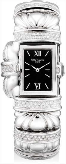 A rare and unusual white gold and diamond-set bracelet watch with concealed dial