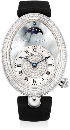 A lady's fine and rare white gold and diamond-set oval wristwatch with moon phases, power reserve and blue mother-of-pearl dial