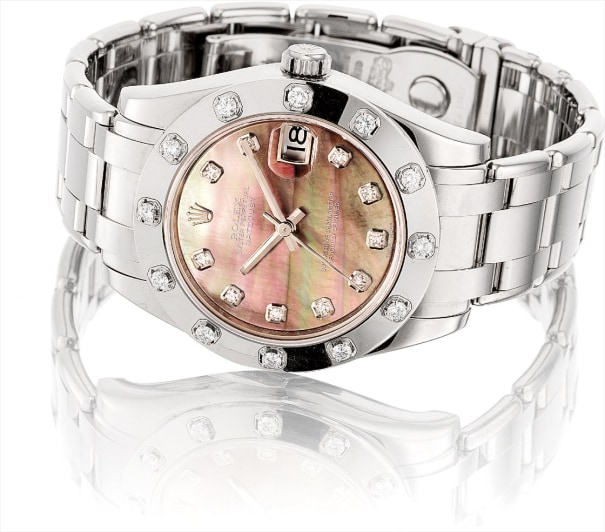 A lady's fine white gold and diamond-set wristwatch with sweep centre seconds, date, mother-of-pearl dial and bracelet
