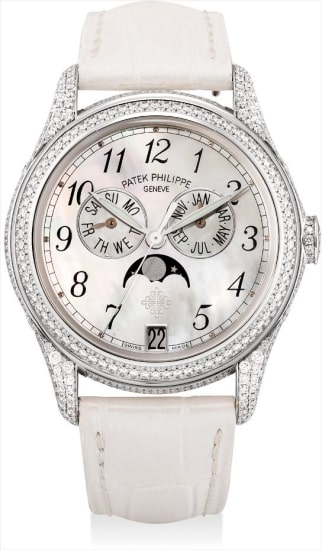 A lady's fine and rare white gold and diamond-set annual calendar wristwatch with sweep centre seconds, moon phases and mother-of-pearl dial
