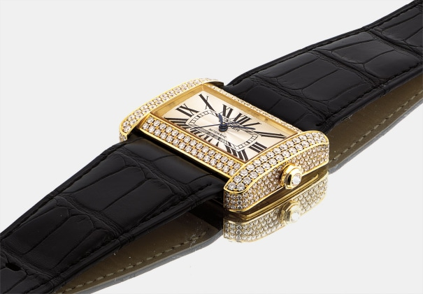 A lady's fine yellow gold and diamond-set rectangular wristwatch with sweep centre seconds
