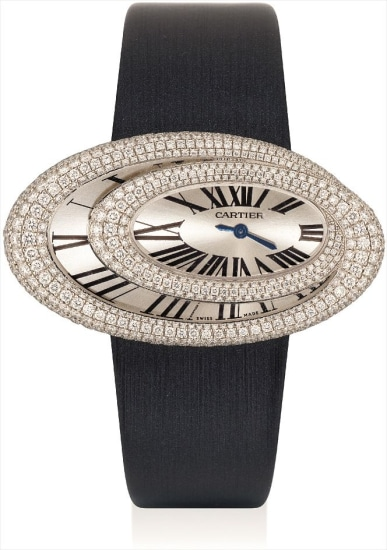 A lady's fine and rare white gold and diamond-set oval wristwatch