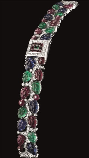 A lady's unique and highly important white gold and multi gem-set tutti frutti bracelet watch with concealed mother-of-pearl dial, original certificate and fitted presentation box