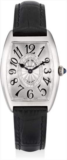 A lady's fine white gold and diamond-set limited edition tonneau-shaped wristwatch