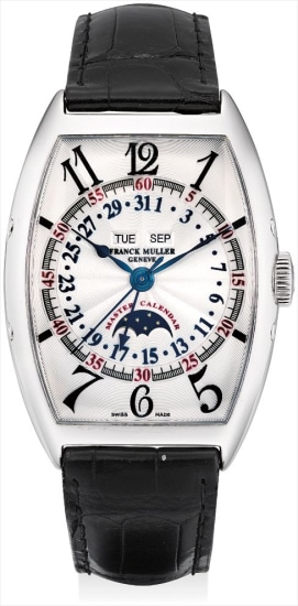 A fine white gold tonneau-shaped triple calendar wristwatch with sweep centre seconds and moon phases